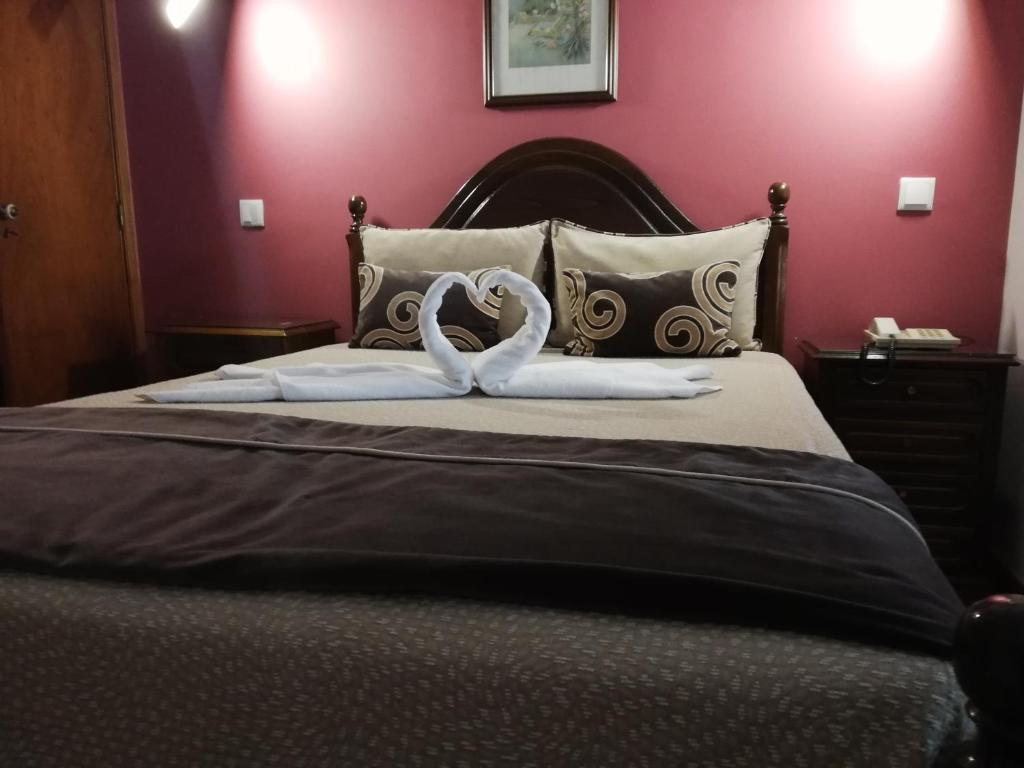 A bed or beds in a room at Hotel Termas