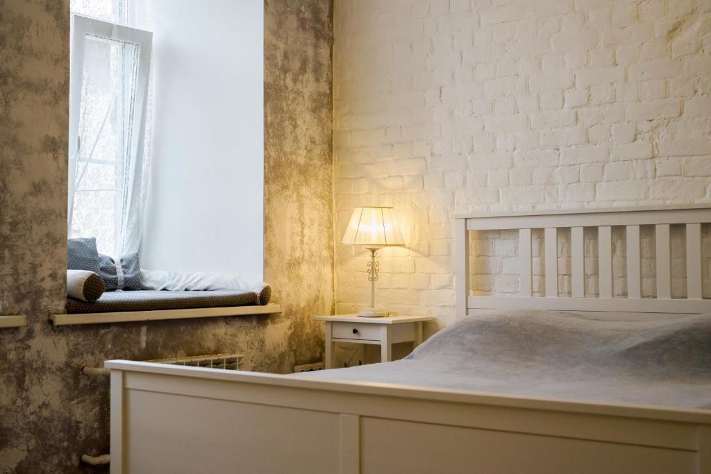 Кровать или кровати в номере Сутки-Дом - Personnage