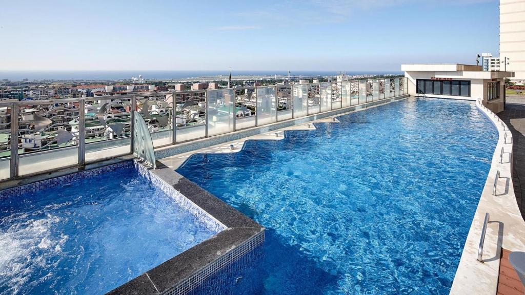 The swimming pool at or near LOTTE City Hotel Jeju