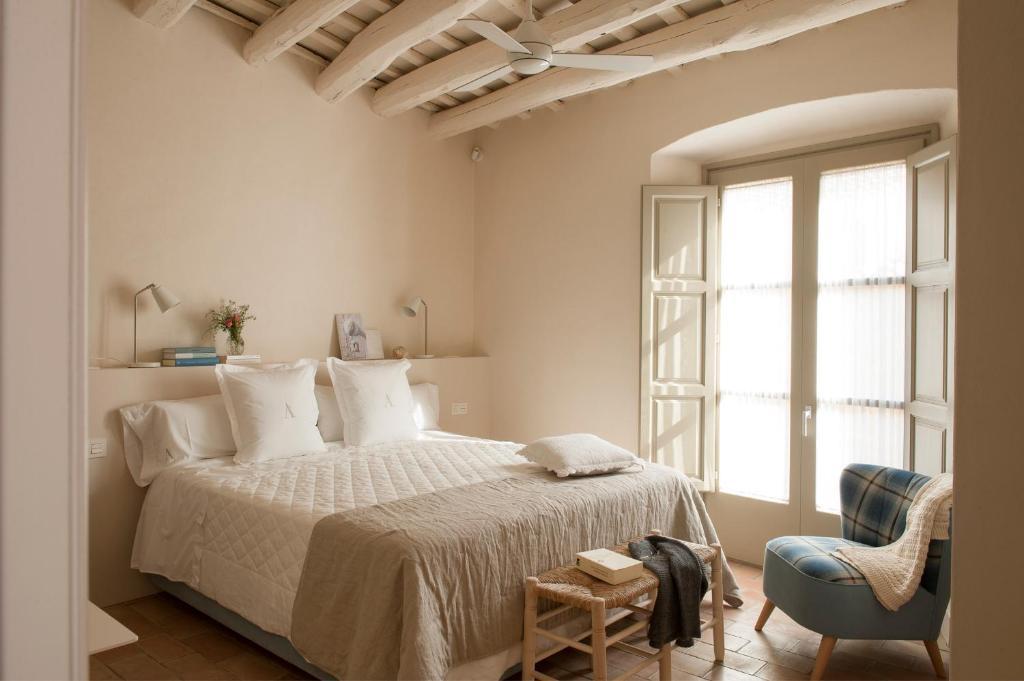 Llit o llits en una habitació de Arkhé Hotel Boutique