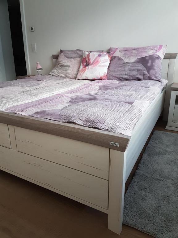 Postel nebo postele na pokoji v ubytování Vienna Home48