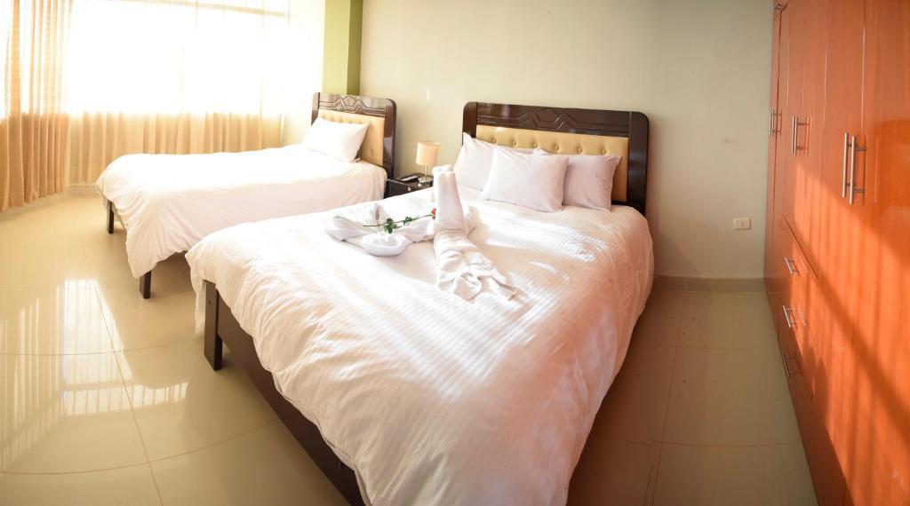 Cama o camas de una habitación en Villas House