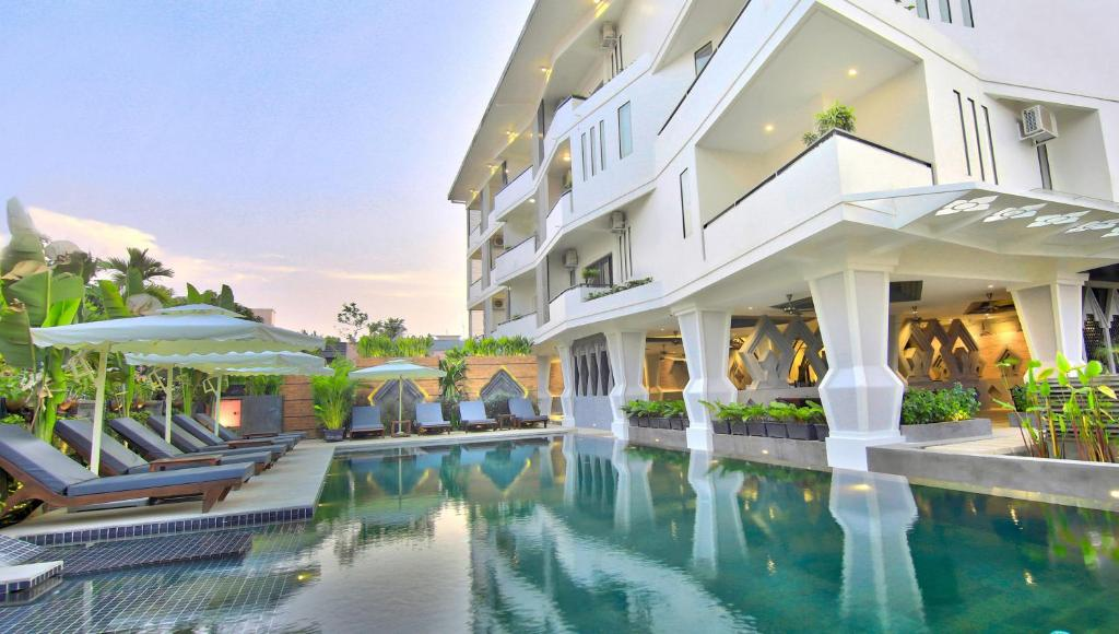 The swimming pool at or near Central Suite Residence