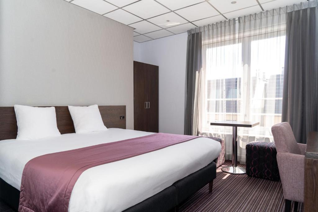 Un ou plusieurs lits dans un hébergement de l'établissement Hotel Luxer