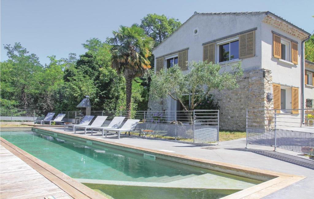 The swimming pool at or near Four-Bedroom Holiday Home in Malataverne
