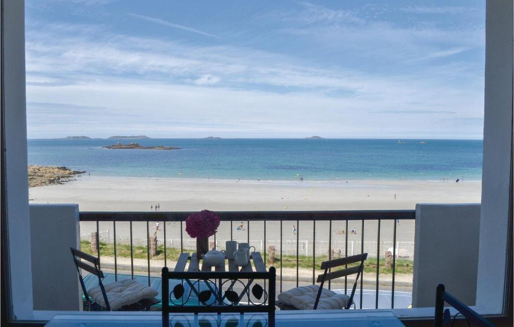 A balcony or terrace at One-Bedroom Apartment in Perros Guirec