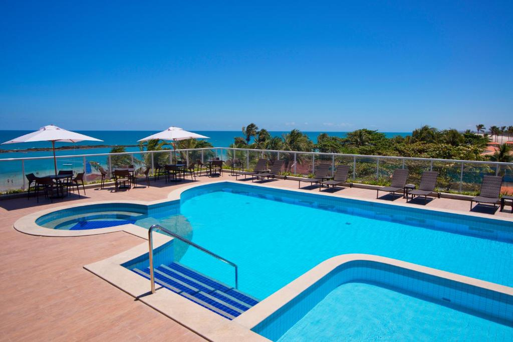 The swimming pool at or close to Hotel Ponta Verde Praia do Francês