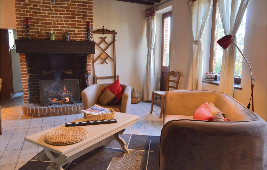 Coin salon dans l'établissement Two-Bedroom Holiday Home in Romery