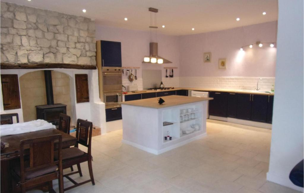 A kitchen or kitchenette at Holiday Home La Blotiere III