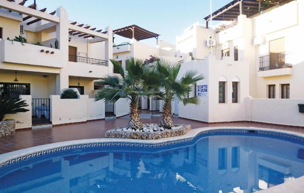 The swimming pool at or near Three-Bedroom Holiday home Nerja with Mountain View 06