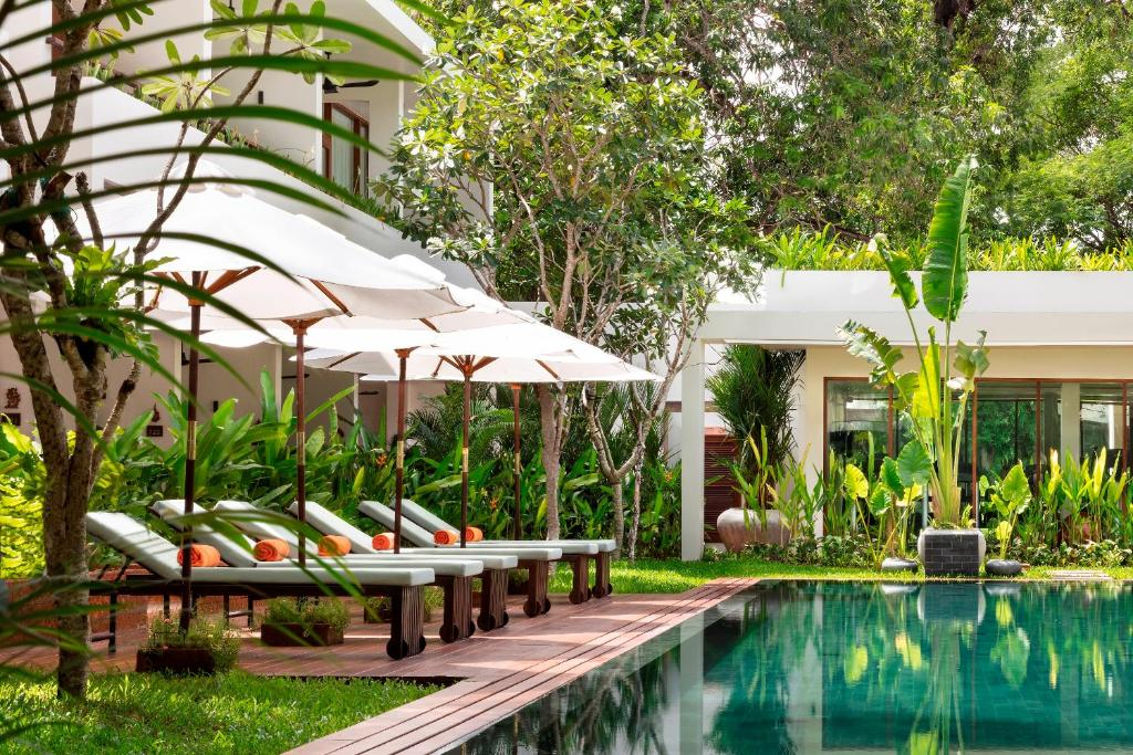 The swimming pool at or close to FCC Angkor by Avani