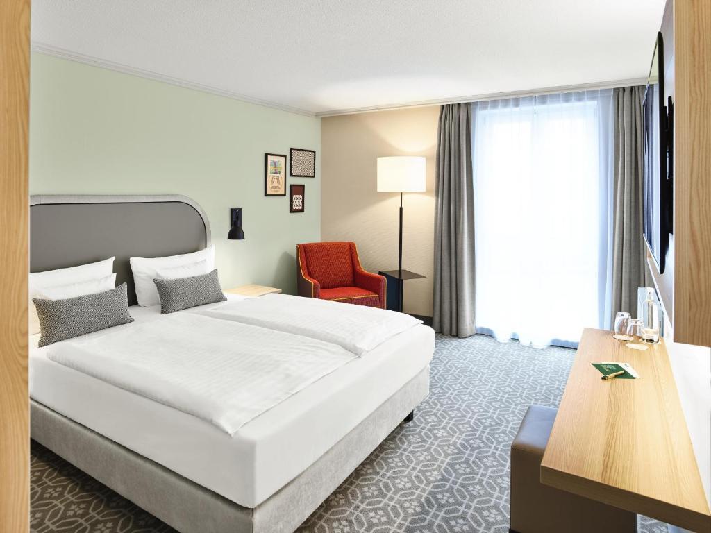 Ein Bett oder Betten in einem Zimmer der Unterkunft MAXX by Steigenberger Sanssouci Potsdam