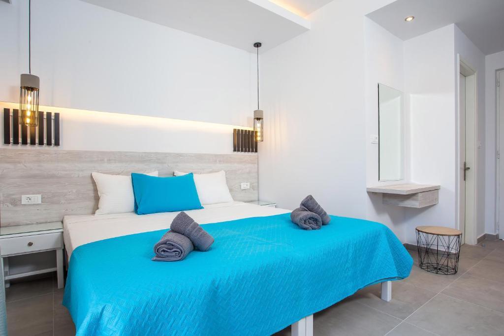 Ένα ή περισσότερα κρεβάτια σε δωμάτιο στο Casastavris