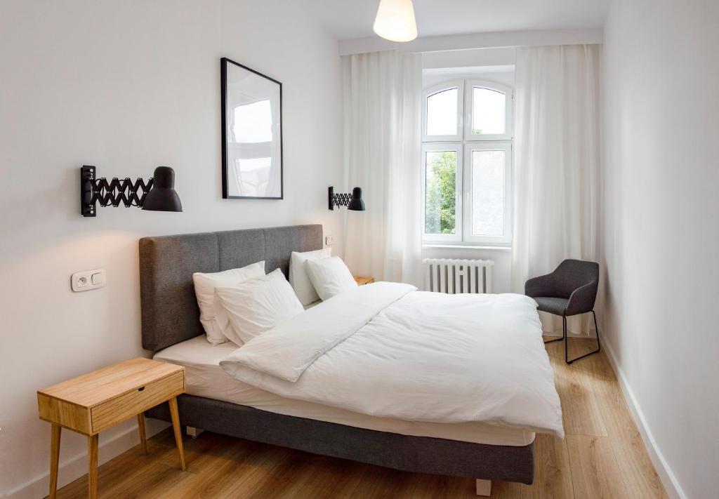 Łóżko lub łóżka w pokoju w obiekcie Centrally Located Island Apartment