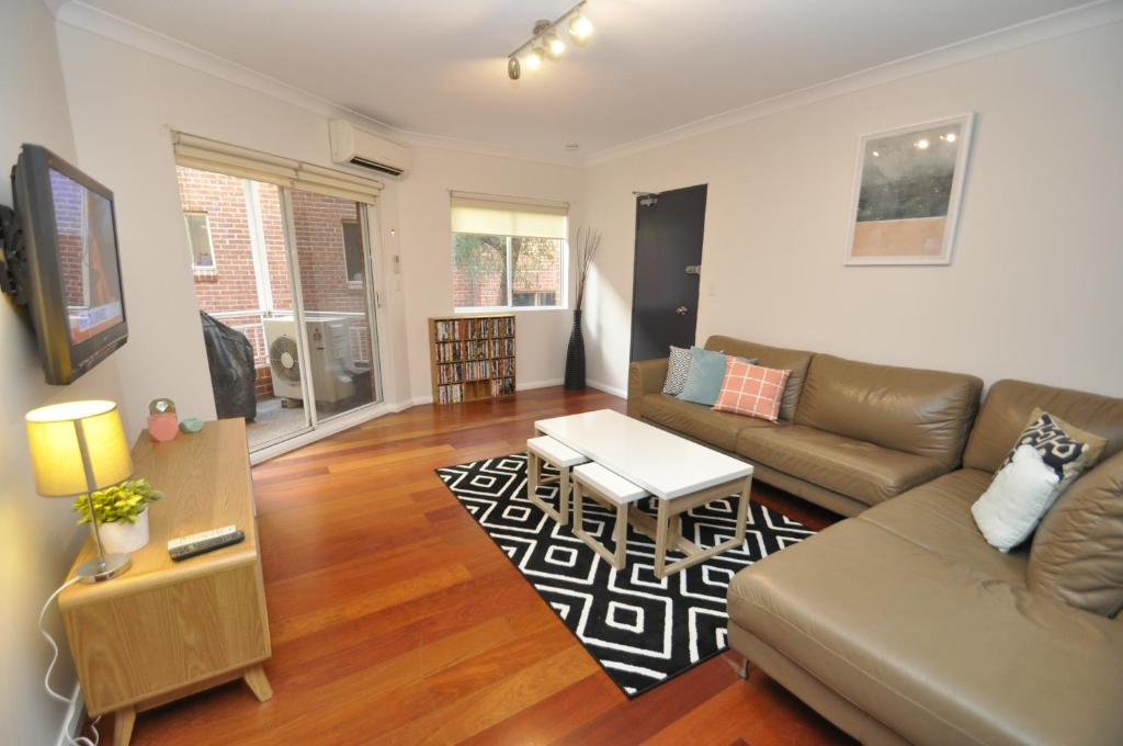 A seating area at Parramatta Self-Contained Two-Bedroom Apartment (4LEN)