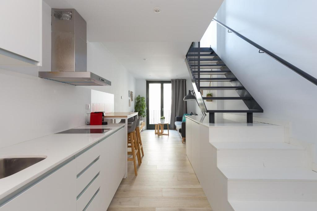 A kitchen or kitchenette at Urban Suites Sitges Apartments