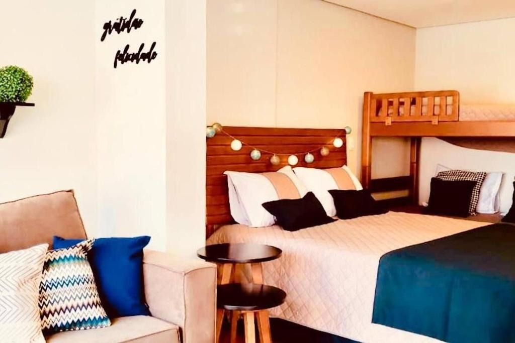 A bed or beds in a room at STUDIOS 195 - Gramado