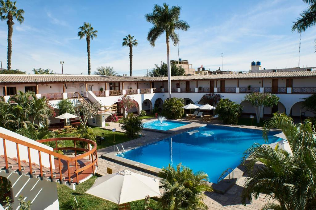 A view of the pool at DM Hoteles Nasca or nearby