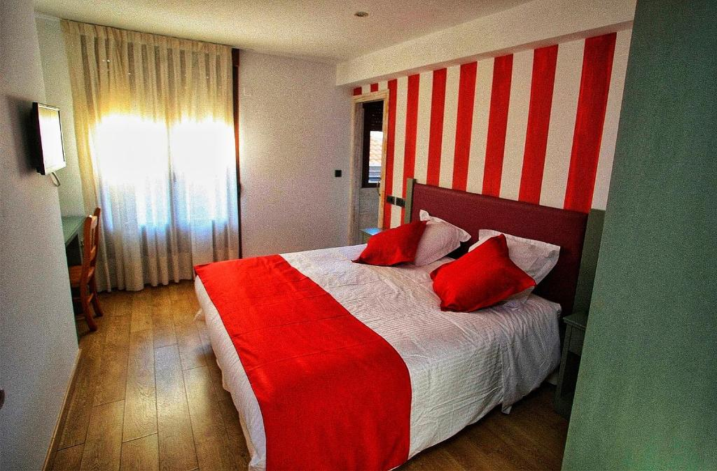 A bed or beds in a room at Boutique Hotel Castilla
