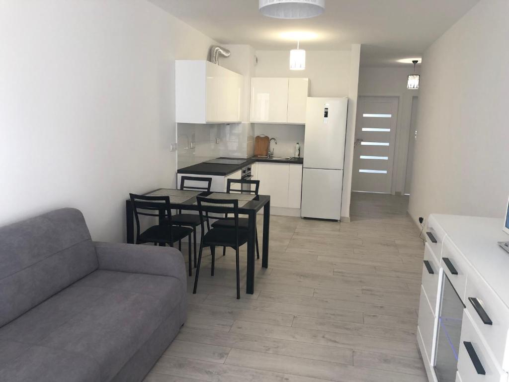 Posezení v ubytování Apartament Winorośli