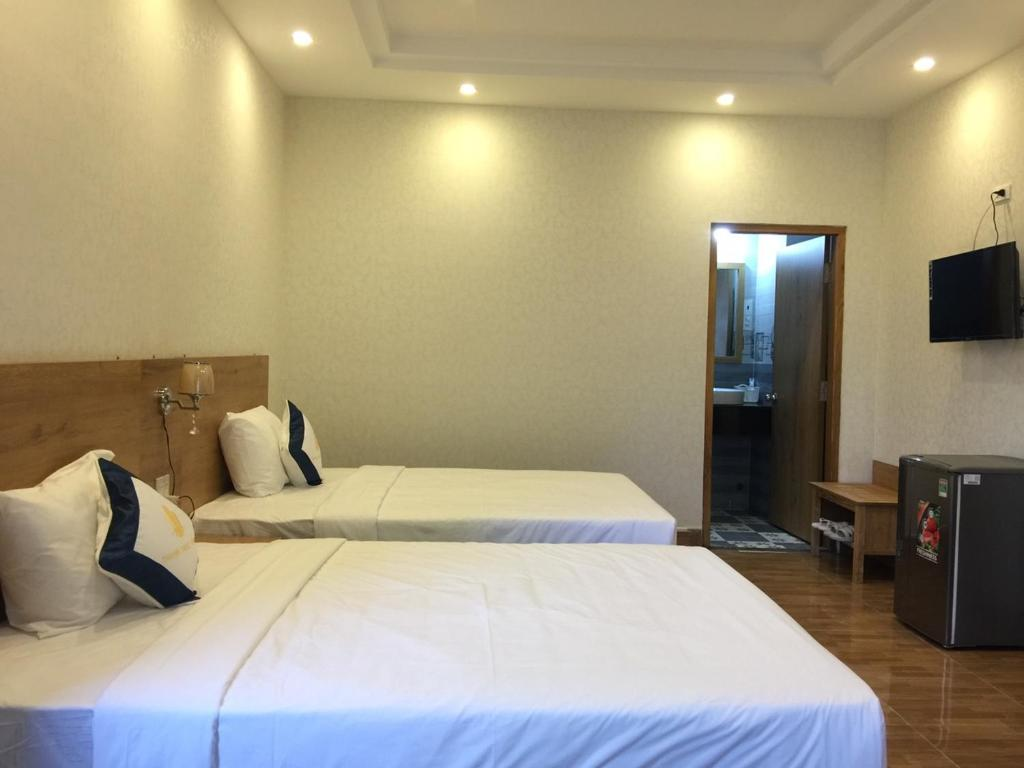 A bed or beds in a room at Thanh Truc Hotel Ca Mau
