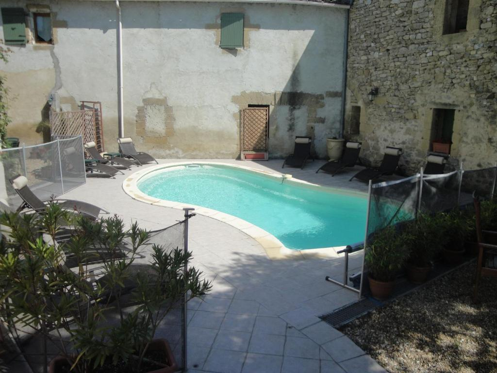 The swimming pool at or near Bastide de la Treille