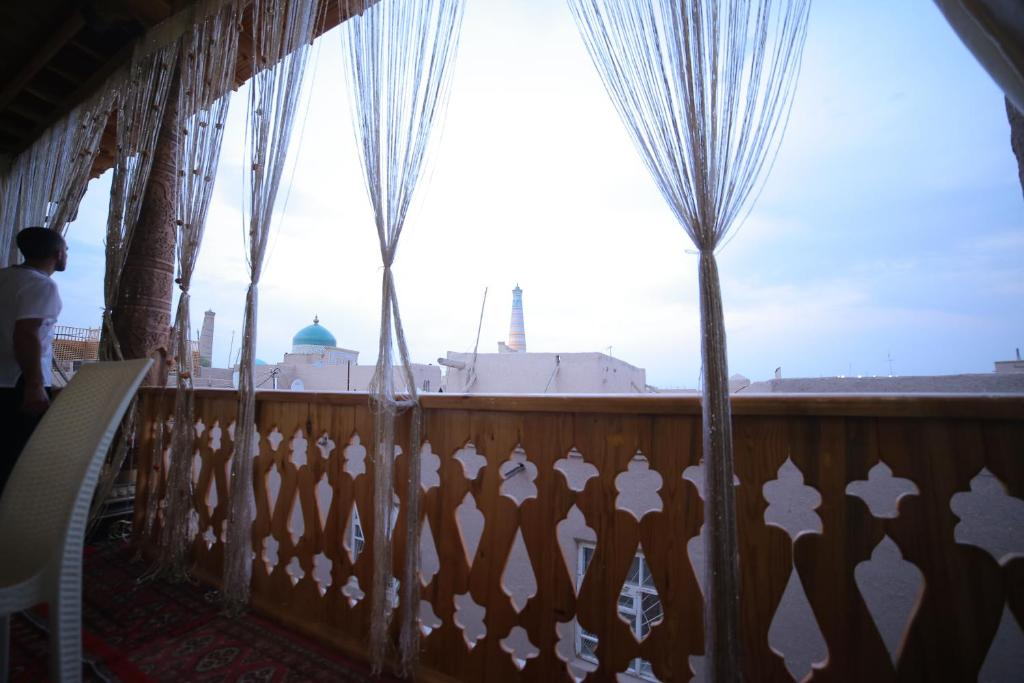 A balcony or terrace at Khiva Rasulboy-Guest House