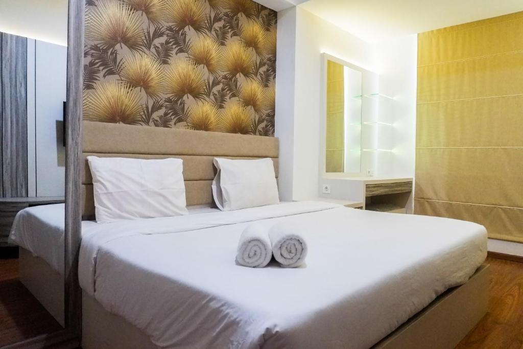 Premium 1BR Apartement At Grand Sungkono Lagoon By Travelio