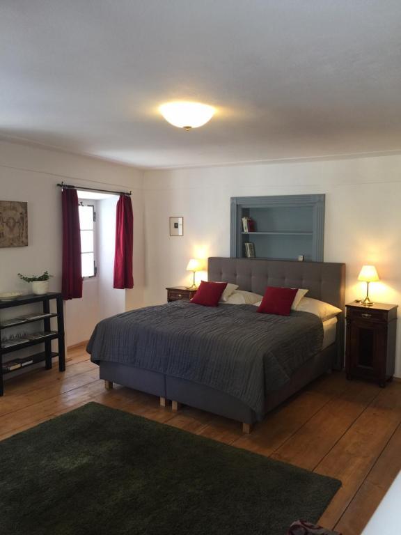 Posteľ alebo postele v izbe v ubytovaní Madona