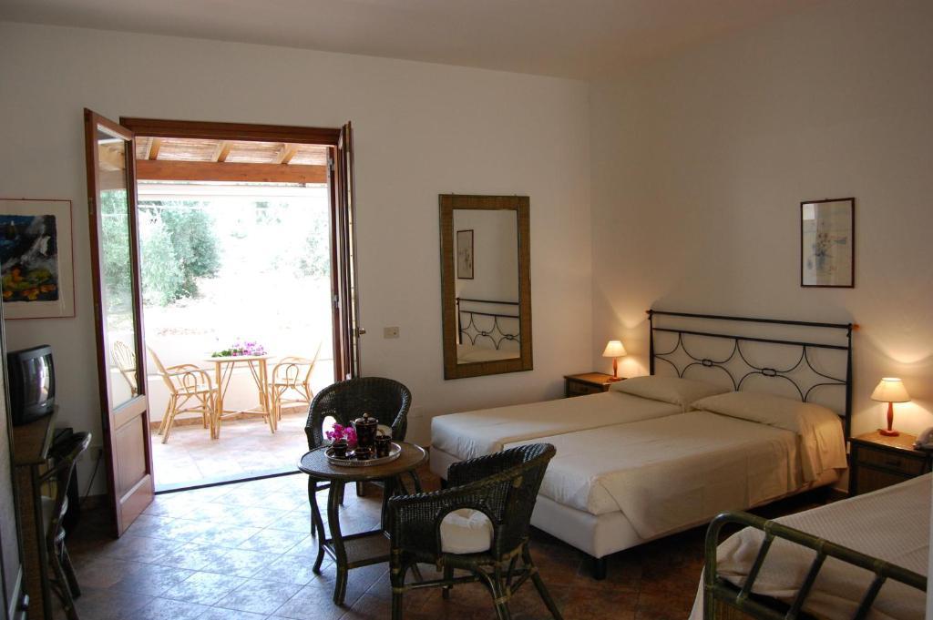 Letto o letti in una camera di Residence Hotel Baia Portinenti