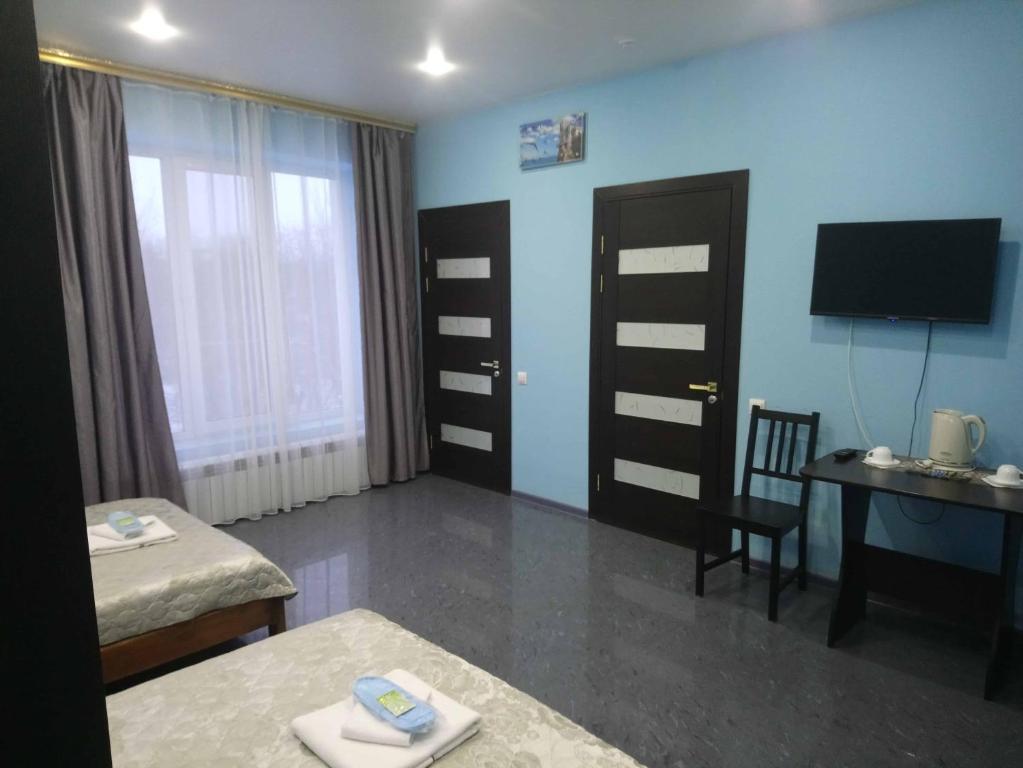 Телевизор и/или развлекательный центр в Lux Guesthouse