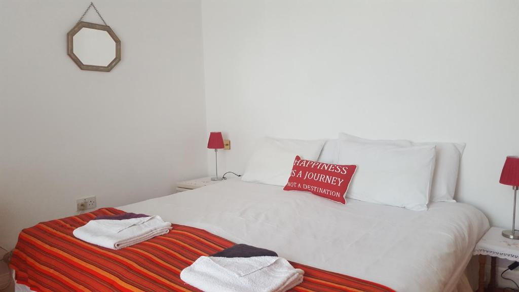 A bed or beds in a room at East Finchley Garden Apartment