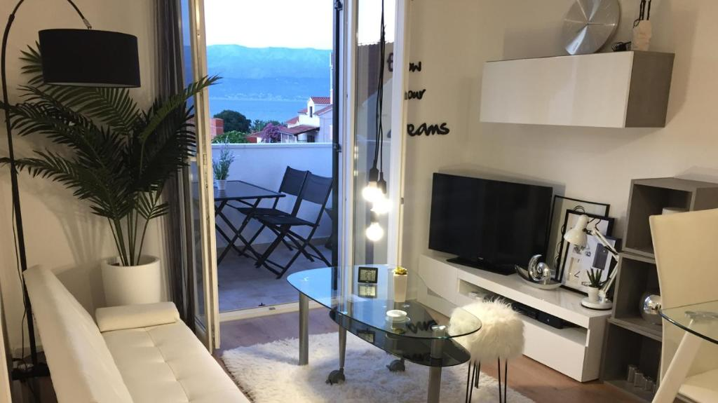 A television and/or entertainment center at Apartment New Chic