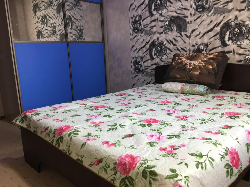 A bed or beds in a room at Baikal