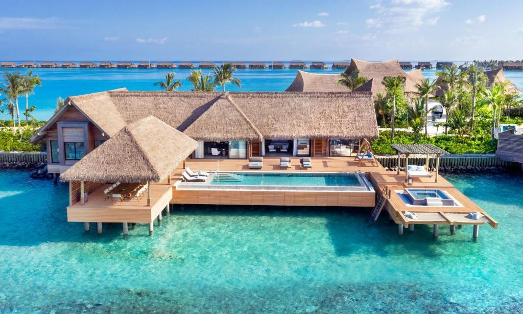 The swimming pool at or near Waldorf Astoria Maldives Ithaafushi