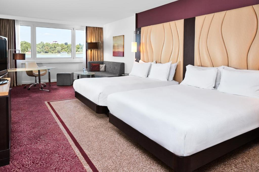 A bed or beds in a room at Hilton Vienna Danube Waterfront