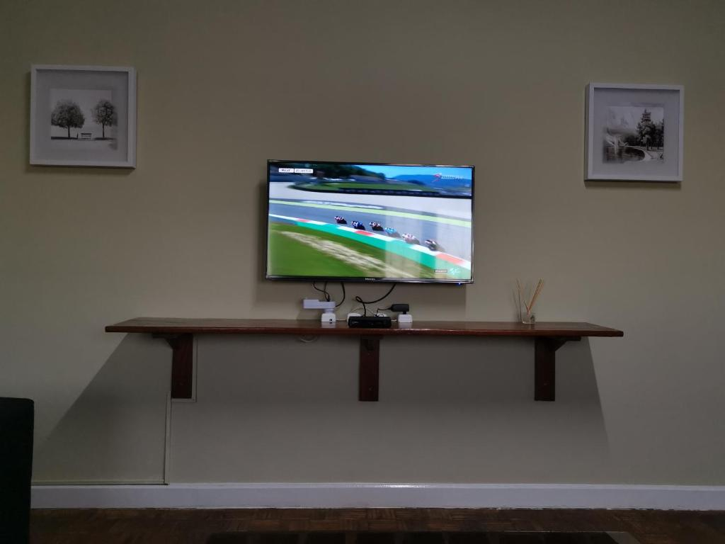 A television and/or entertainment center at TD Guest House