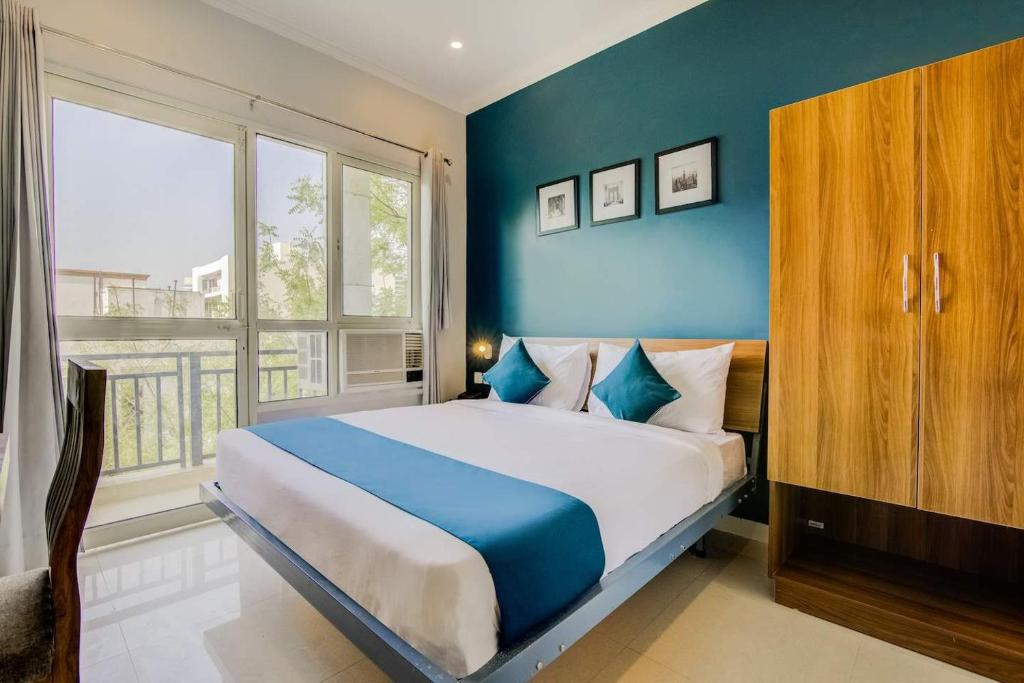 A bed or beds in a room at CT Lite Madhuvan