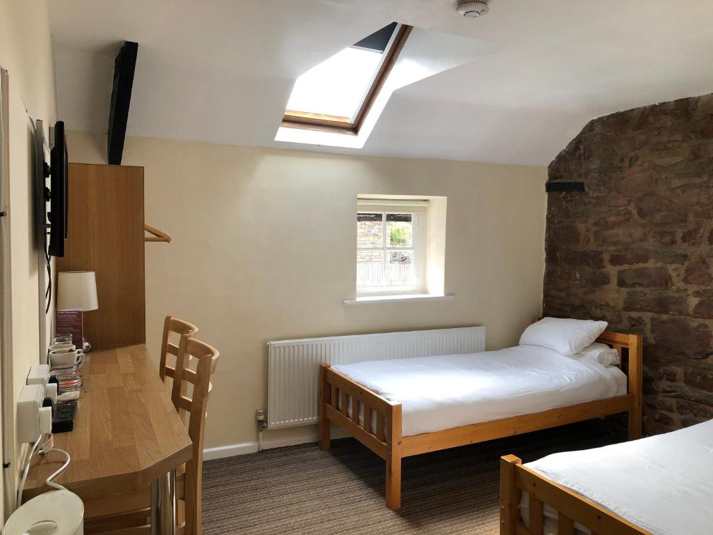 A bed or beds in a room at Butchers Arms