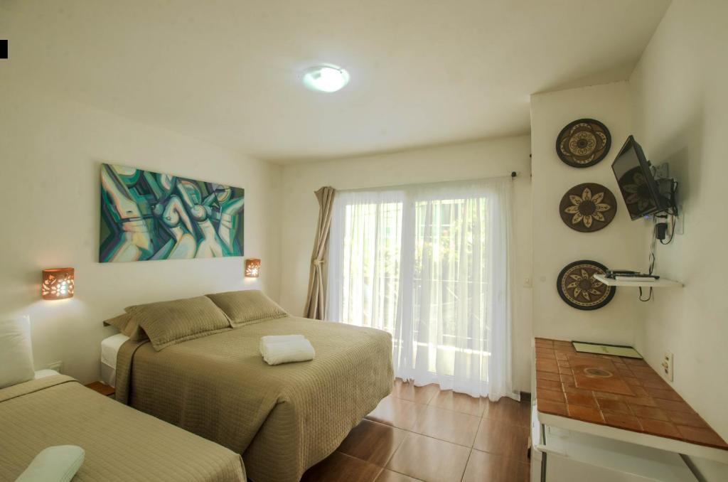A bed or beds in a room at Pousada Borboleta
