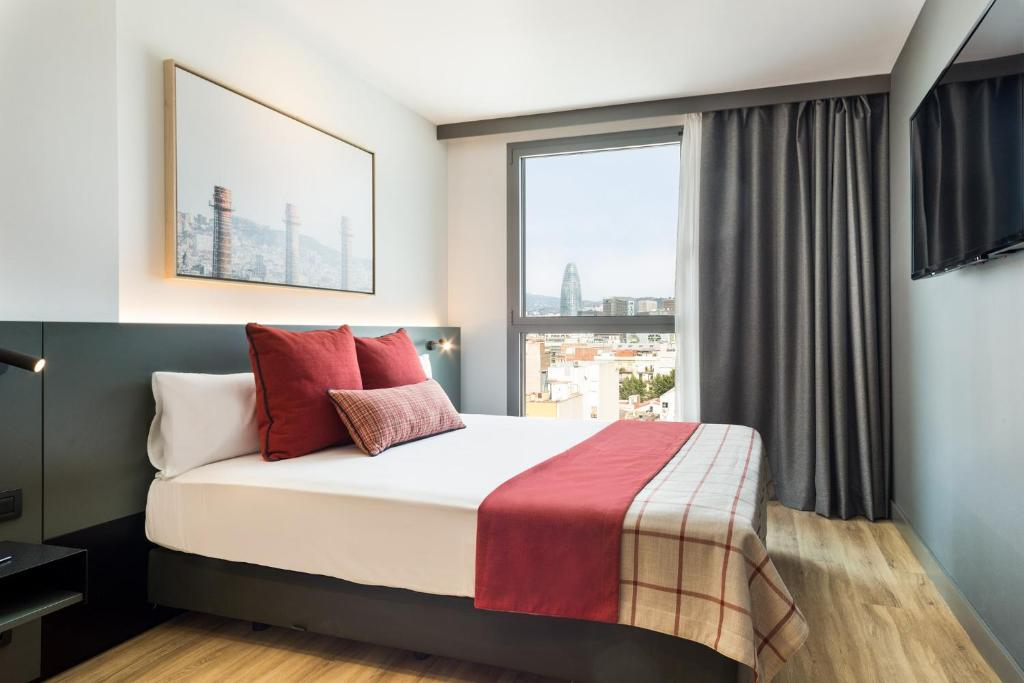 A bed or beds in a room at Acta Voraport