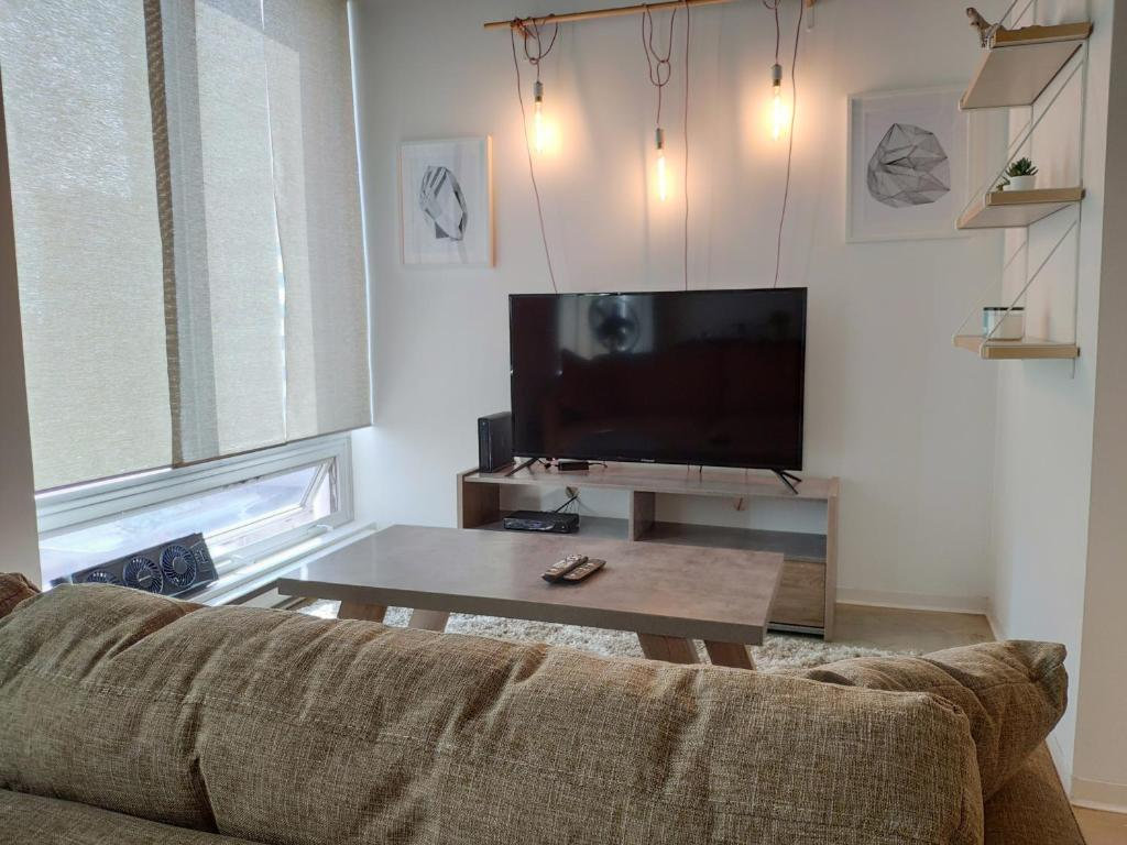 A television and/or entertainment centre at Modern DOWNTOWN Loft Near ROGERS PLACE,SHAW CONF
