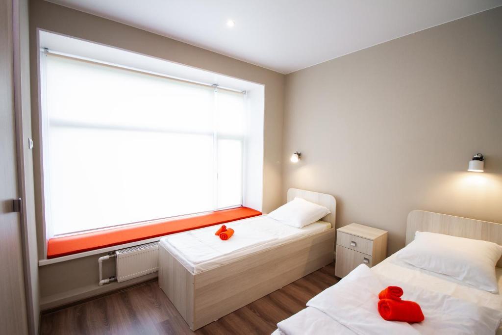 Ein Bett oder Betten in einem Zimmer der Unterkunft RABISON
