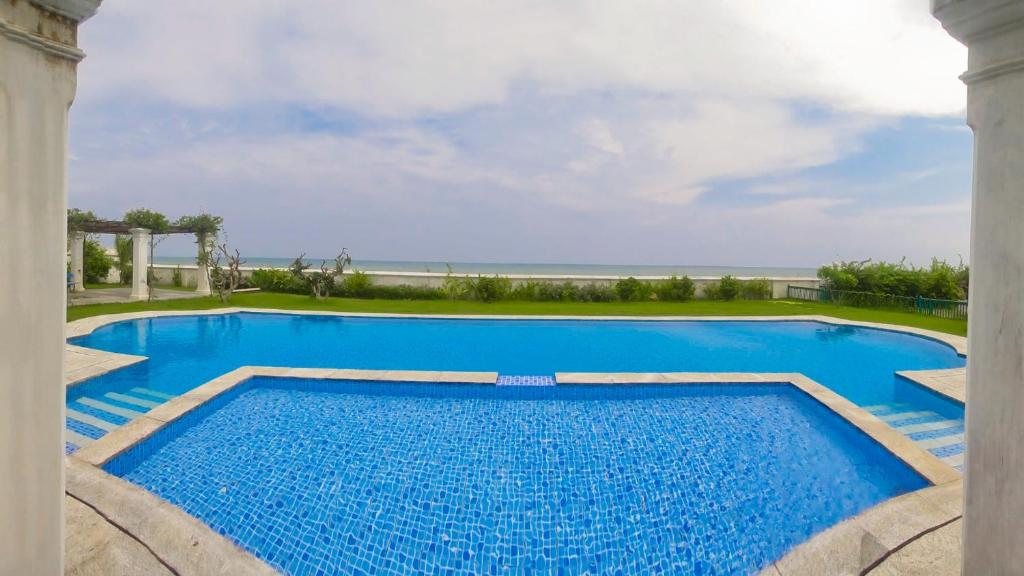 The swimming pool at or near Neemrana's - Bungalow on The Beach
