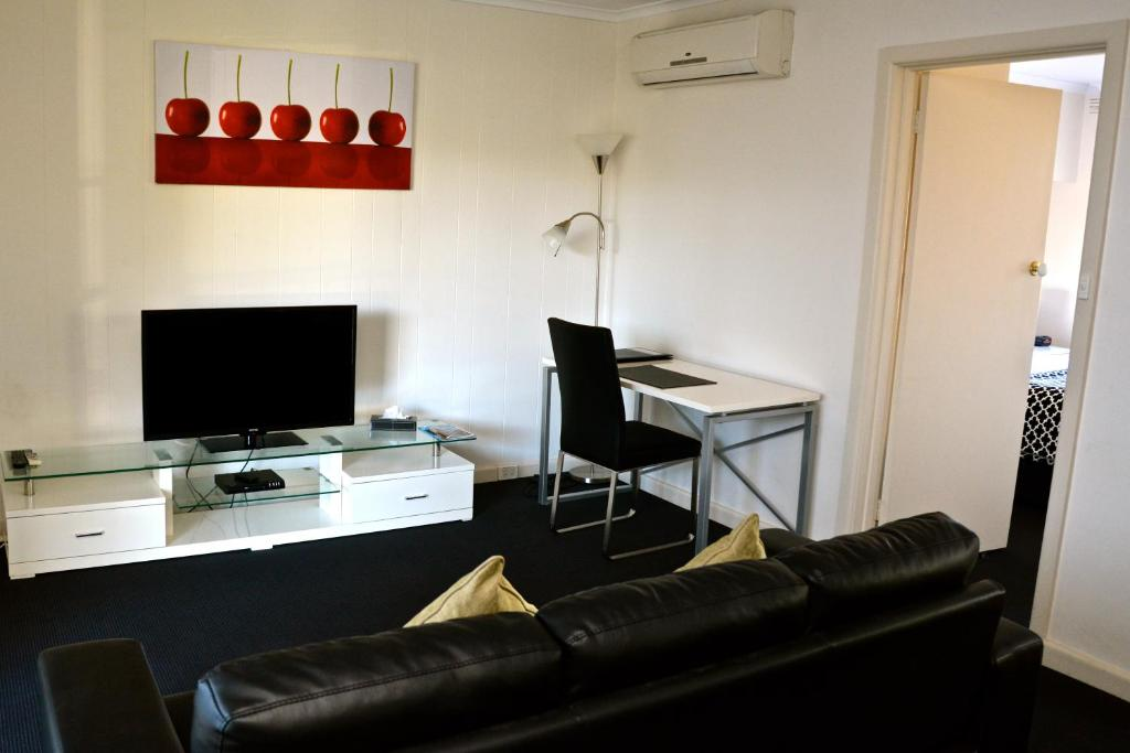 A television and/or entertainment center at Essendon Apartments