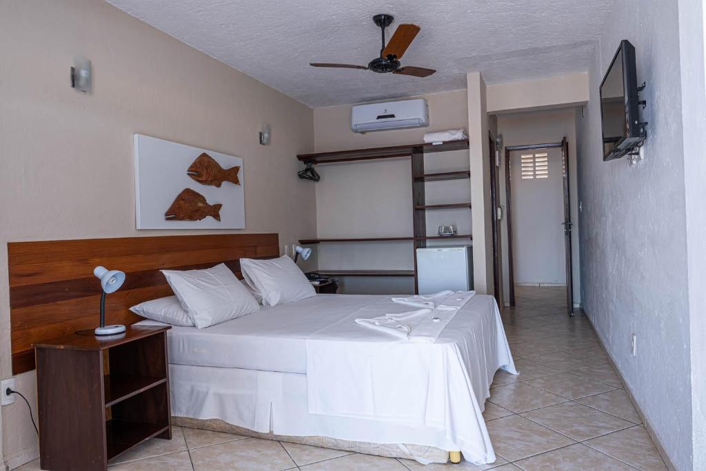 Cama ou camas em um quarto em Pousada Villa do Sol