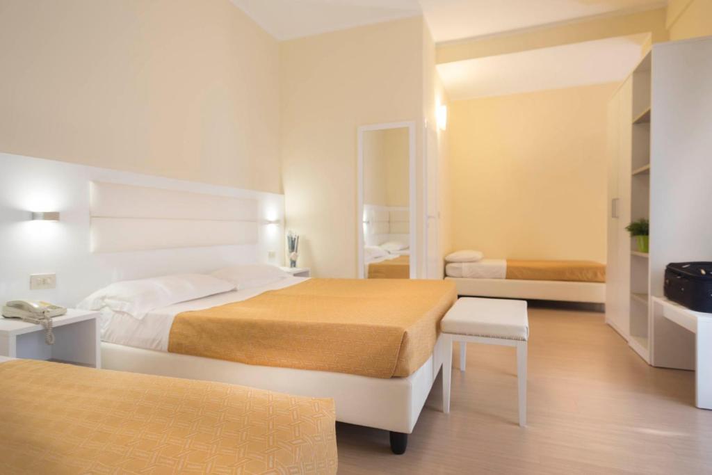Letto o letti in una camera di Hotel San Domingo