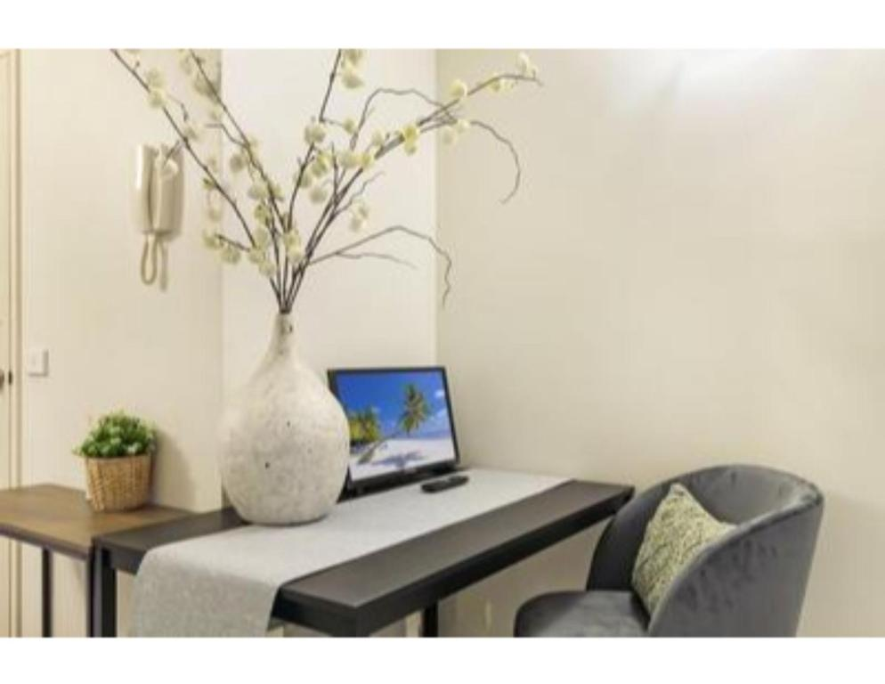 A television and/or entertainment center at Super Convenient Studio Located in Melbourne CBD