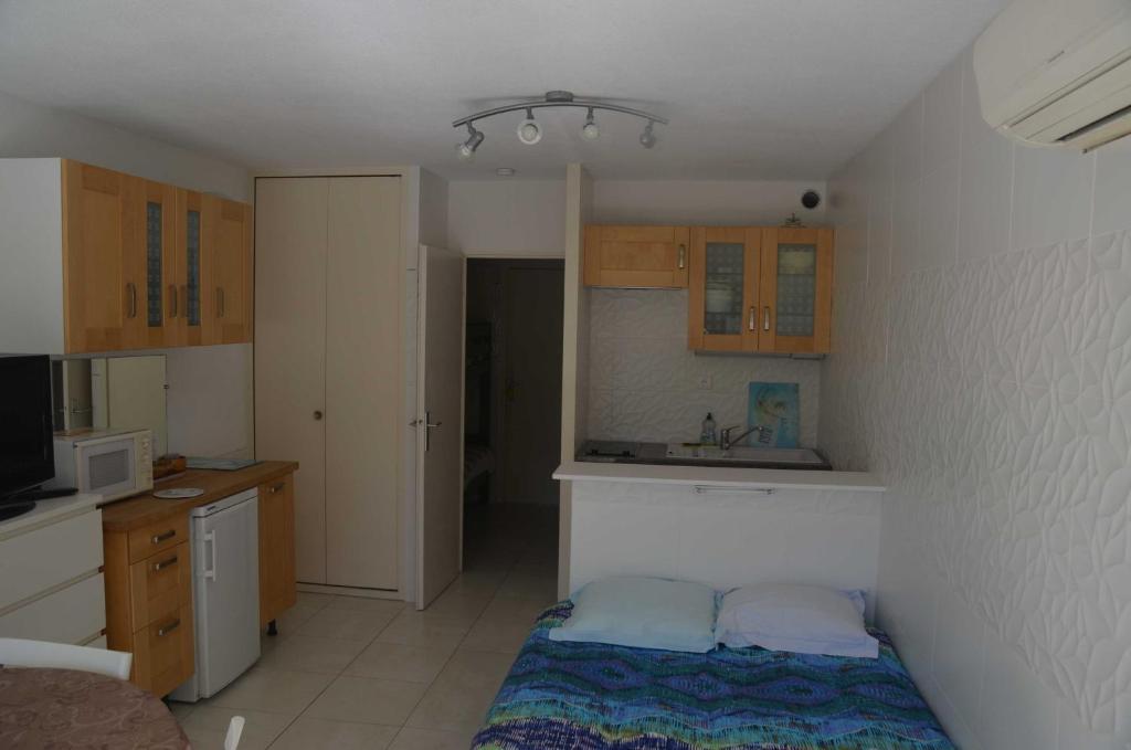 A kitchen or kitchenette at Port-Vincent