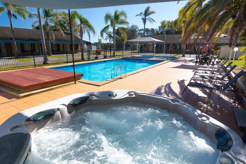 The swimming pool at or near Seashells Beachfront Resort